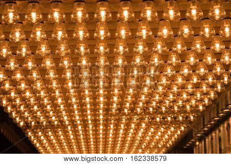 Ceiling covered in filament light bulbs for background use