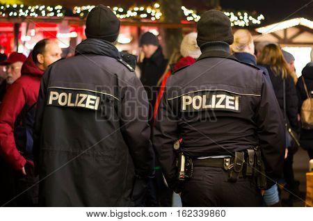 Frankfurt am Main, Hessen, Germany - December 09, 2016: Policemen walking through Christmas market in Frankfurt am Main.