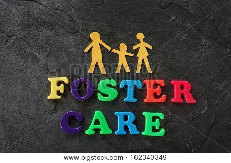 Paper family with colorful Foster Care letters