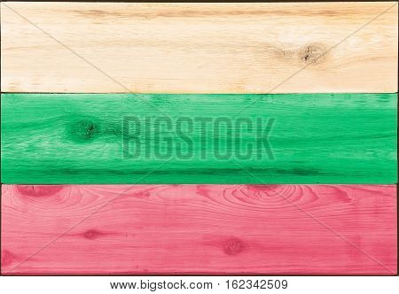 Timber planks of wood that have been painted or stained in the colors of a Bulgarian flag as a background
