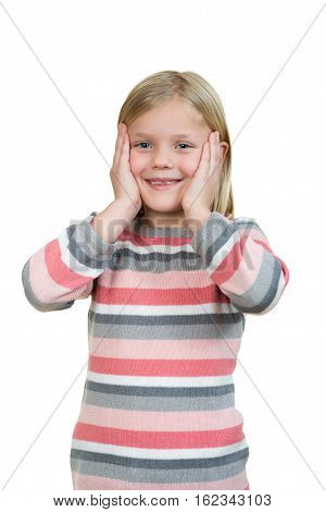 Cute girl is holding her face in astonishment and looking up, isolated over white.