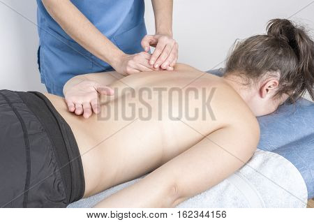 Physiotherapist, Chiropractor Giving A Massage And Stretching Of Subscapularis And Rhomboid