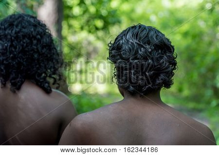 Vedda people walking in jungle. Veddas are an indigenous people of Sri Lanka living in tribes in the jungle