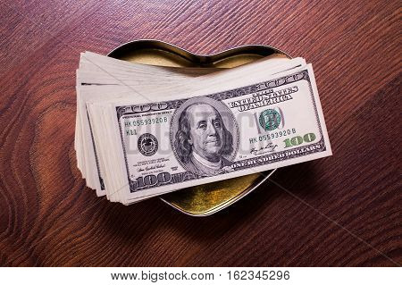 money in the heart love friendship and money business plan money background hundred dollar bills front side. background of dollars money and feelings