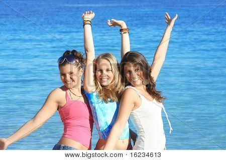 3 teens posing on beach