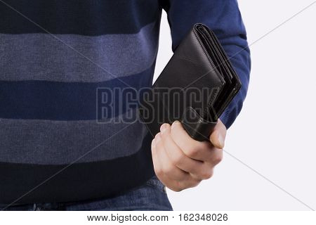 man holding in his hand a black closed purse