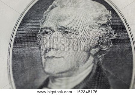 the first Treasury Secretary Alexander Hamilton on ten dollar bill money background ten dollar bills front side obverse. background of dollars close up America