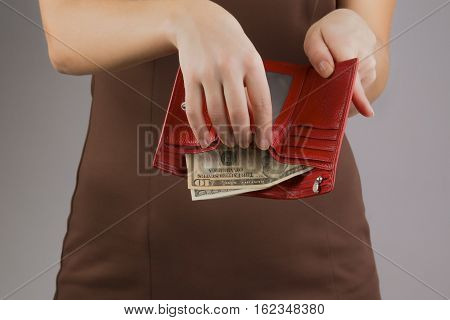 purse with money in the hands of women spending money