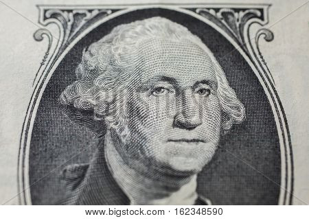 portrait of the first president of the United States the US founding father George Washington on the one dollar bill background of the money one dollar bills front side obverse. background of dollars close up America