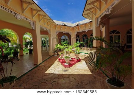 Cayo Coco island, Memories Caribe resort, Cuba, June 28. 2016, amazing gorgeous natural landscape view of Memories Caribe hotel grounds and stylish beautiful architecture with open roof and blue sky