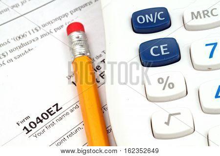 A form 1040EZ with tax prep tools