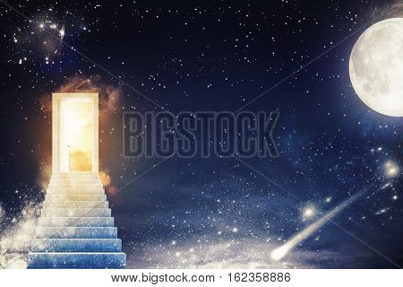 Door with sunlight on a starry sky with the moon and the stars