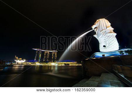 Singapore - June 24, 2016: Merlion fountain and marina bay at night, Singapore