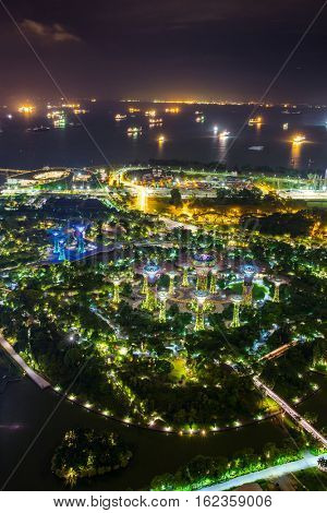 Singapore - June 26, 2016: Night view of illuminated Supertree Grove at Gardens by the Bay from the Marina Bay Sands Hotel  in Singapore
