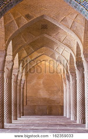 Shiraz, Iran - December 26, 2015: Beautiful columns in Vakil Mosque, Shiraz, Iran