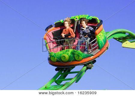 SOME MOTION BLUR DUE TO FAST SPEED. fun at the fun fair