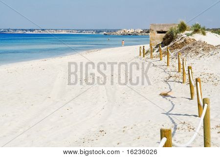 Es trenc, nudist beach with two naked men in far distance (bodies altered and unrecognizable)