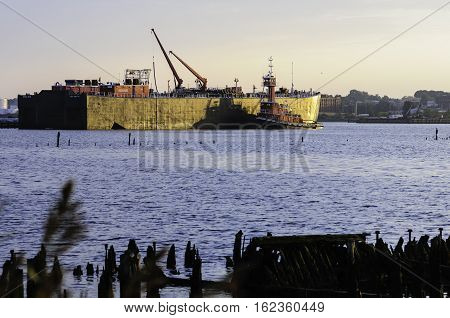 Providence Rhode Island USA - October 1 2008: 400-foot Bouchard B. No. 210 barge and tug on Providence River