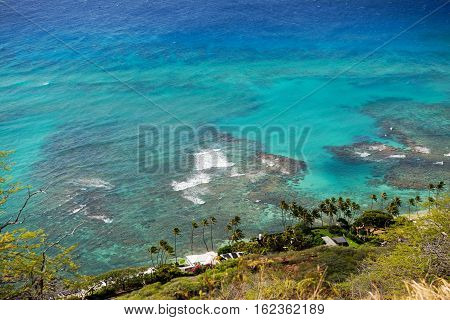 Beautiful view from the top of the Diamond Head crater over some residences and some of the coastal coral reefs