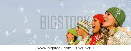 christmas carolers with falling snow