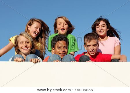group of kids holding placard with copy space