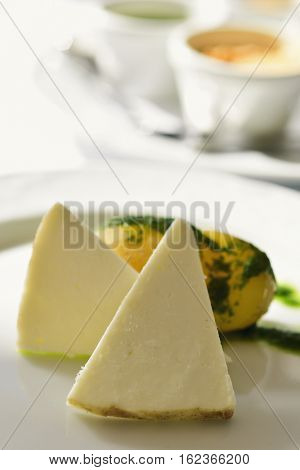 closeup of some pieces of majorero cheese from Fuerteventura, Spain, on a white ceramic plate, on a table