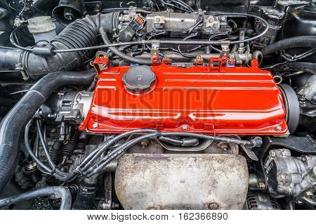 Labuan,Malaysia-Nov 1,2016:An engine red cover with power of the Proton Wira in Labuan,Malaysia.Its a car manufactured by Malaysian carmaker Proton and is based on the Mitsubishi Lancer platform.