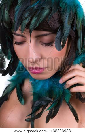 Iridescent feather headpiece on a beautiful woman