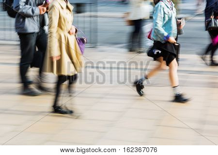 Pedestrians On The Sidewalk In The City