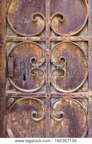 Old Ornated And Rusted Metal Door