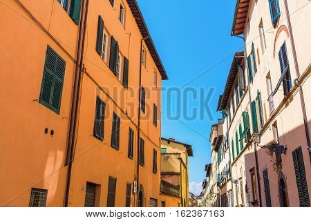 Road With Old Buildings In Lucca