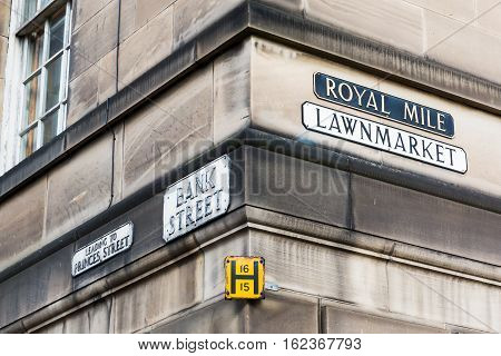 street name signs at a house wall in Edinburgh Scotland UK
