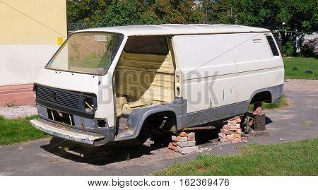 GOMEL, BELARUS - SEPTEMBER 6, 2016: Old Grunge Rusty Volkswagen Van. Volkswagen  is a German automaker, headquartered in Wolfsburg, Germany.