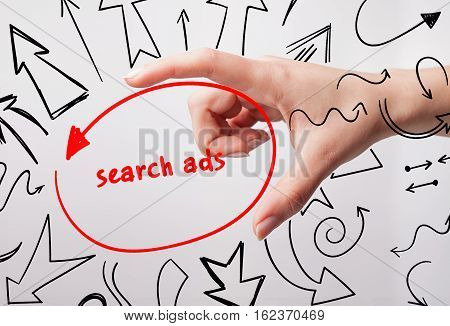 Technology, Internet, Business And Marketing. Young Business Woman Writing Word: Search Ads