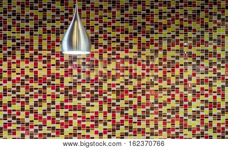 colorful ceramic tiles background with stainless steel alloy lantern