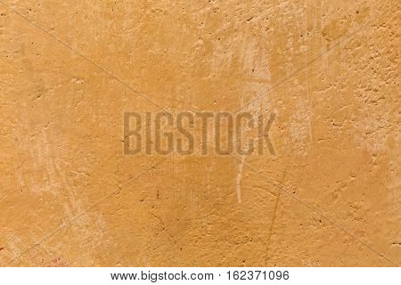 decorative background texture of a mud colored wall