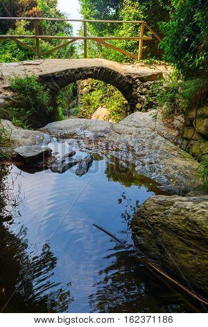 old stone arch bridge at the coastal trail of the Cinque Terre Italy