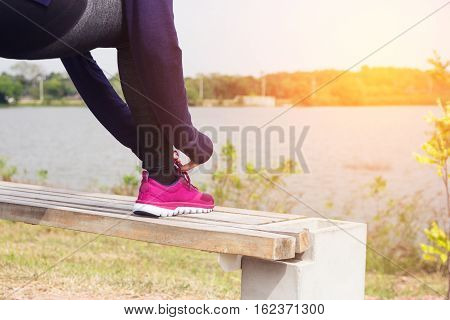 Young woman is running in sunny nature background.