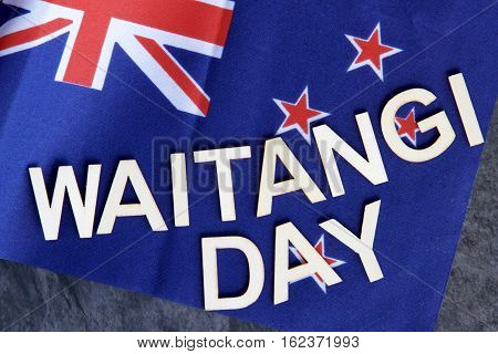 Waitangi or (Independence Day) signage on a New Zealand flag.