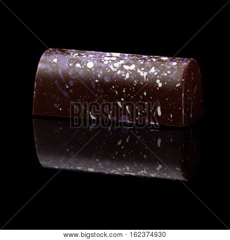 chocolate candy on black background