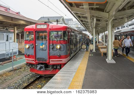 TOKYO, JAPAN - 20 NOV 2016 : Train stopped at Karuizawa Railway station.The railway system is one of the most important public transportation in Japan.