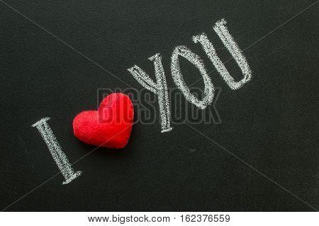 I Love You. Handwritten message on black chalkboard