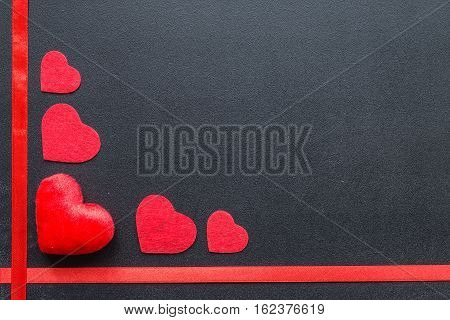 Red hearts on black chalkboard. Valentine's day
