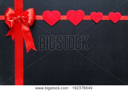 Red hearts on black boards. Valentine's day