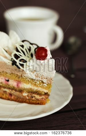 Cake With Cream And Cherry On A Dark Background