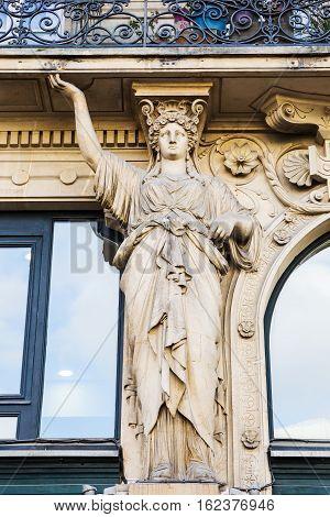 Atlas Sculpture At An Old Building In Paris