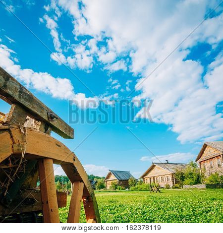 Country landscape with farmhouses and beautiful blue sky with cumulus clouds in the background