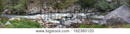 A panoramic photo of the Big Thompson River in Colorado.