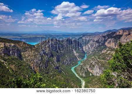The largest alpine canyon Verdon spring. Turquoise water of the river is flowing at the bottom of the gorge. Canyon of Verdon, Provence