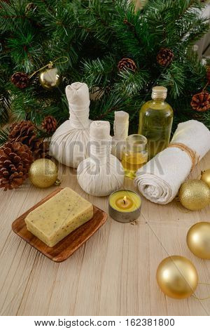 Christmas spa with Composition of treatment and wooden backgground